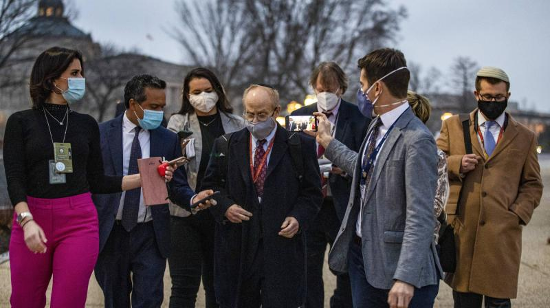David Schoen, lawyer for former President Donald Trump, talks to reporters as he departs the U.S. Capitol on the third day of Trump's second impeachment trial on February 11, 2021 in Washington, DC.  (Tasos Katopodis/Getty Images/AFP)