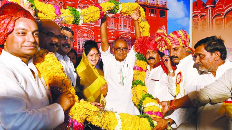 A file photo of Digvijay Singh and his wife Amrita Rai Singh being welcomed during the 'parichay sammelan' of Madhya Pradesh Rajput Samaj in Bhopal.