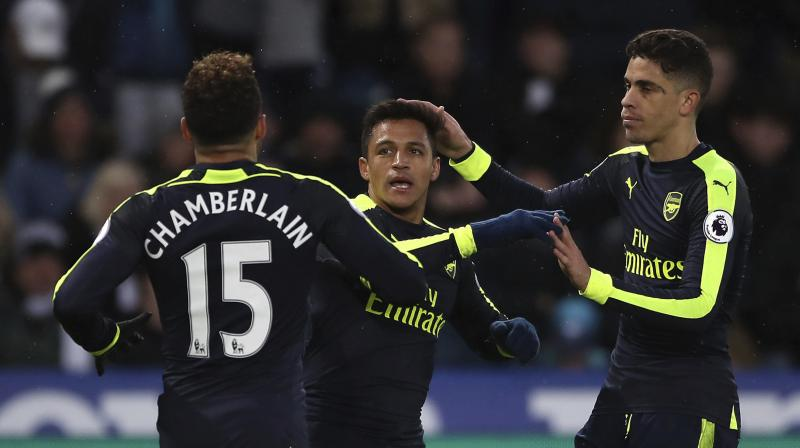 Between Giroud's opener and Alexis Sanchez's 73rd minute effort, Paul Clement, in his first league game in charge of the Swans, also had to watch miserably as Jack Cork and Kyle Naughton put past their own keeper from Alex Iwobi shots. (Photo: AP)