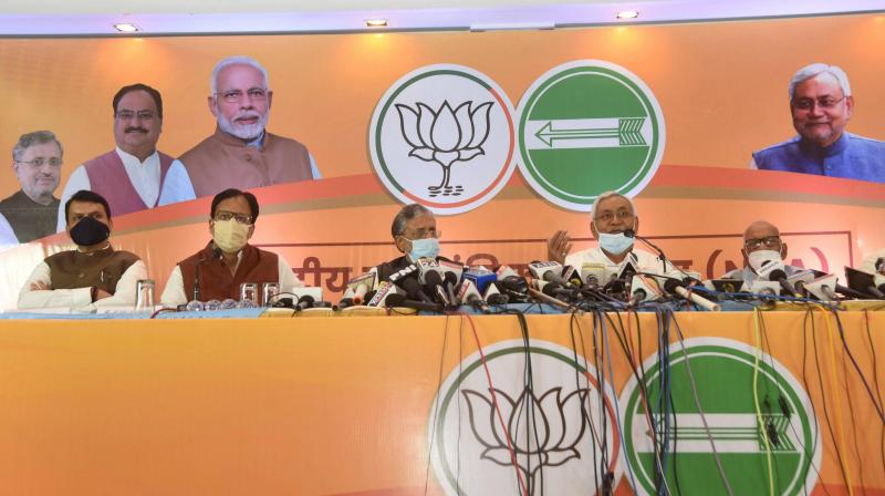 Bihar chief minister and NDU president Nitish Kumar with senior BJP leader and deputy CM Sushil Kumar Modi at a press conference in Patna ahead of Bihar polls. — PTI photo