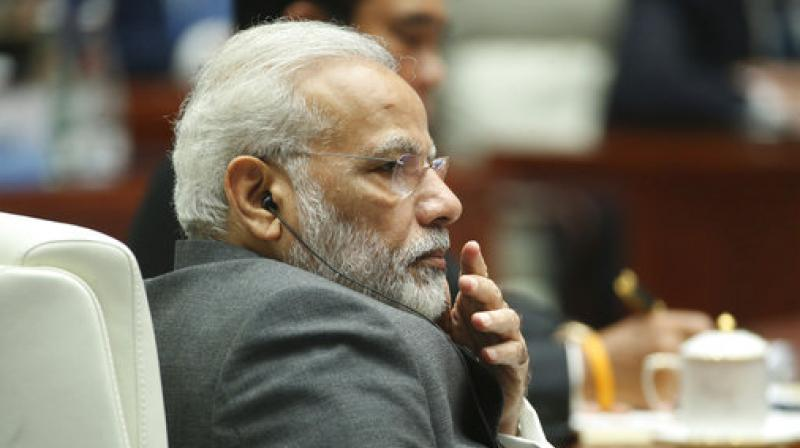 Indian Prime Minister Narendra Modi attends the Dialogue of Emerging Market and Developing Countries on the sideline of the BRICS Summit in Xiamen, China, on Sept 5, 2017. (Photo: AP)