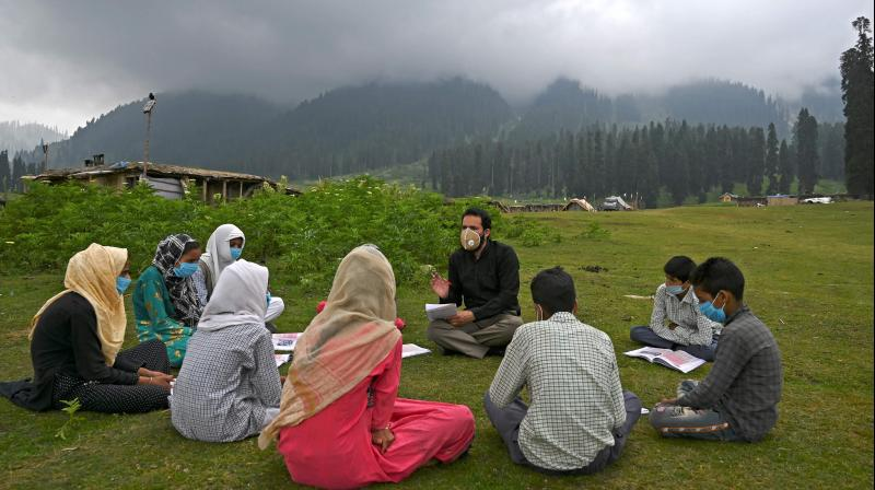 Students attend a class at their open-air school situated on top of a mountain in Doodhpathri, Kashmir. AFP Photo