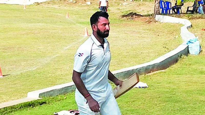 Cheteshwar Pujara walks back to the pavilion after scoring a  century on his TNCA first  division league debut. (Photo: DC)