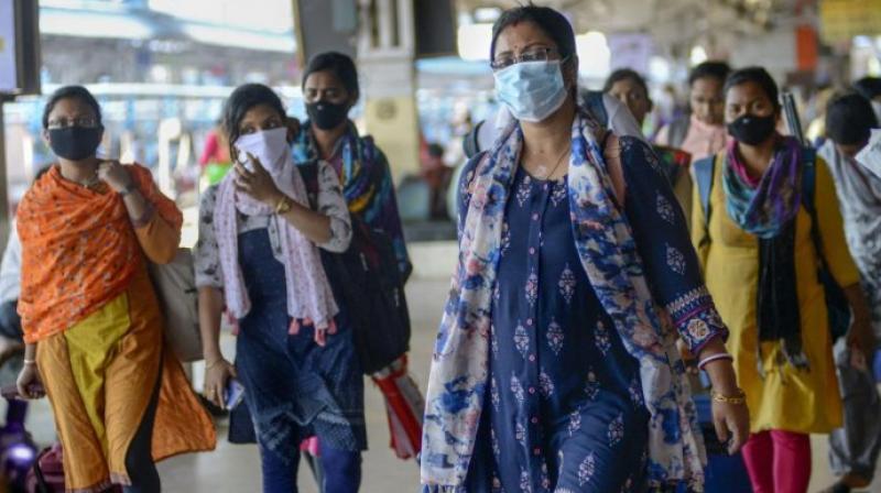 Passengers wear masks as a preventive measure against coronavirus (PTI Photo)