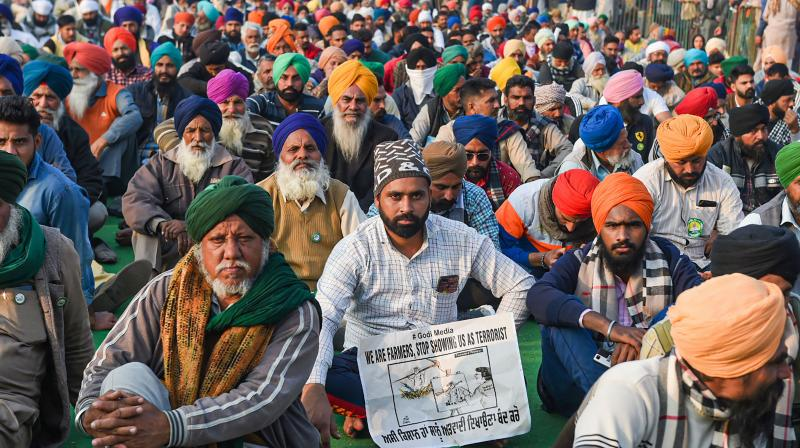 Farmers during their protest against the Center's new farm laws, at Singhu Border in New Delhi, Thursday, Dec. 24, 2020. (PTI)