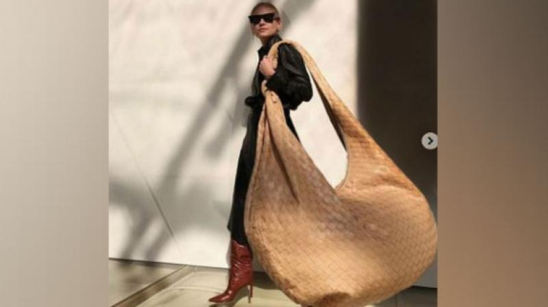 The carry-your-whole- life-with-you- totes is a departure from the mini and micro bags that have been in vogue over the past few months. (Photo: ANI)