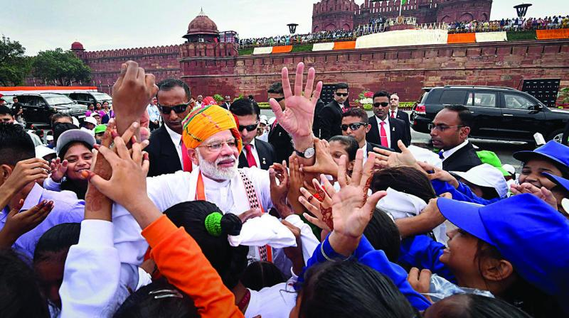Prime Minister Narendra Modi interacts with schoolchildren after addressing the nation from the ramparts of the Red Fort on the occasion of the 73rd Independence Day in New Delhi on Thursday. (Photo: PTI)
