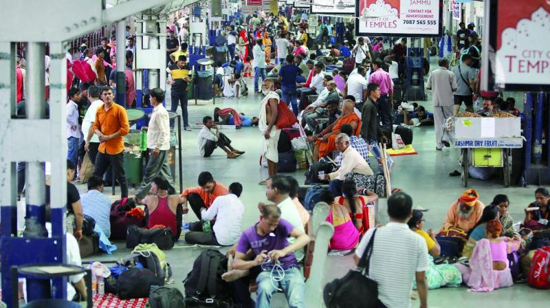 Tourists and passengers wait for their trains at Jammu Railway Station on Saturday. (Photo: PTI)