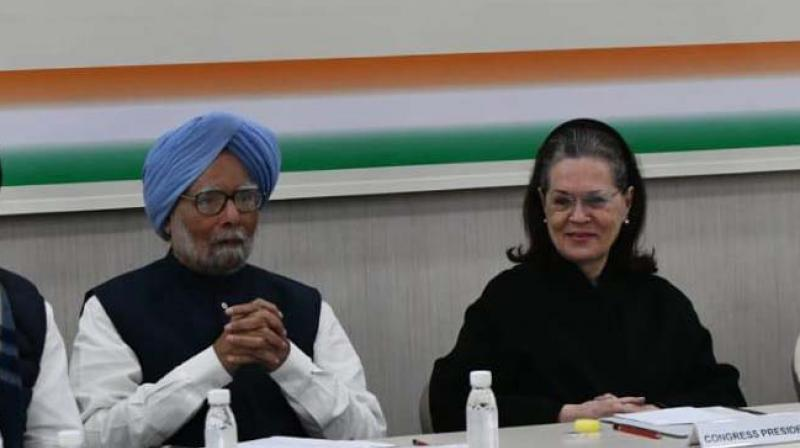 Congress president Sonia Gandhi with former Prime Minister Manmohan Singh during CWC meeting in New Delhi on Saturday. (Photo: Asian Age)