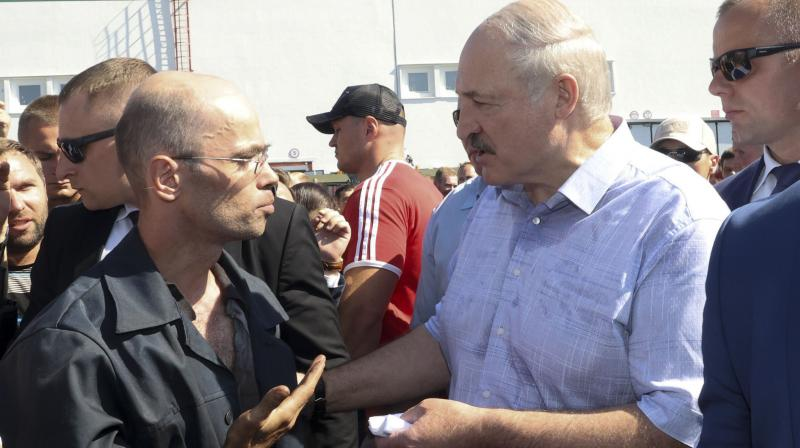 Belarusian President Alexander Lukashenko, second right, argues with a worker of the Minsk Wheel Tractor Plant in Minsk, Belarus. — AP photo