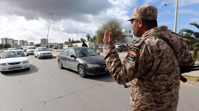 A soldier from the Libyan army mans a checkpoint in the capital Tripoli. (AFP)