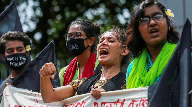 Students shout slogans to protest against an alleged gang-rape and stripping and torturing of a woman in the southern district of Noakhali during a demonstration in Dhaka. (AFP)