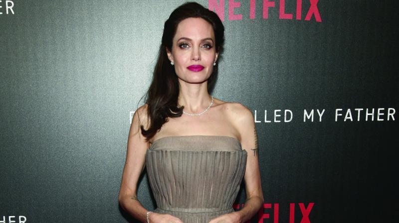 Angelina Jolies Kids Wear Yellow Flowers