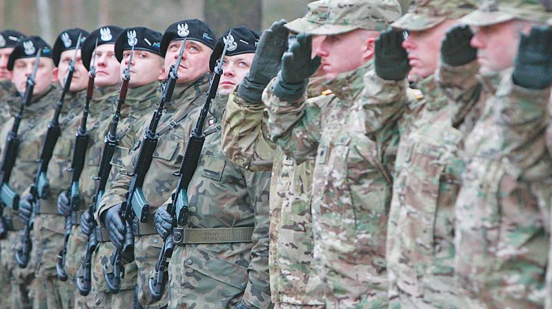 US soldiers being welcomed in Zagan, Poland, on Thursday. The troops arrived at the Zagan base in western Poland. (Photo: AP)