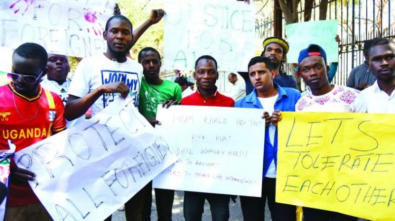 African students protest the attack against the attack on a Congolese national in Delhi.