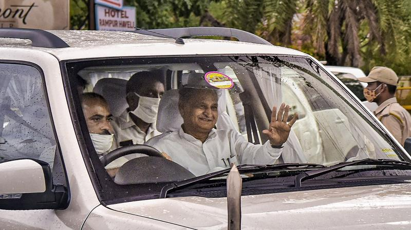 Rajasthan Chief Minister Ashok Gehlot leaves from a hotel, in Jaipur, Saturday. PTI Photo