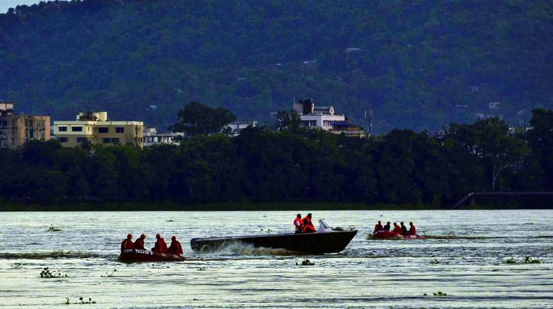 National Disaster Response Force personnel on boats search in the Brahmaputra river after a boat capsized on the outskirts of Guwahati on Wednesday. (Photo: AP)