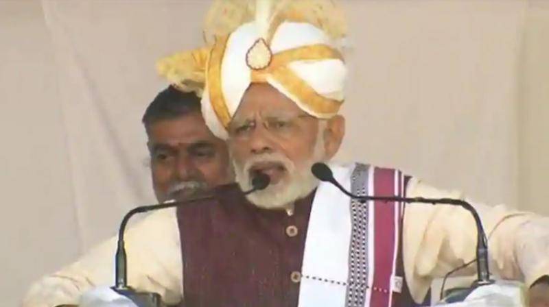 Prime Minister Narendra Modi on Friday assured the people of Assam that no genuine citizen will be left out of the NRC and hoped that the citizenship bill will be soon get Parliament's nod. (Photo: Twitter/BJP4India)
