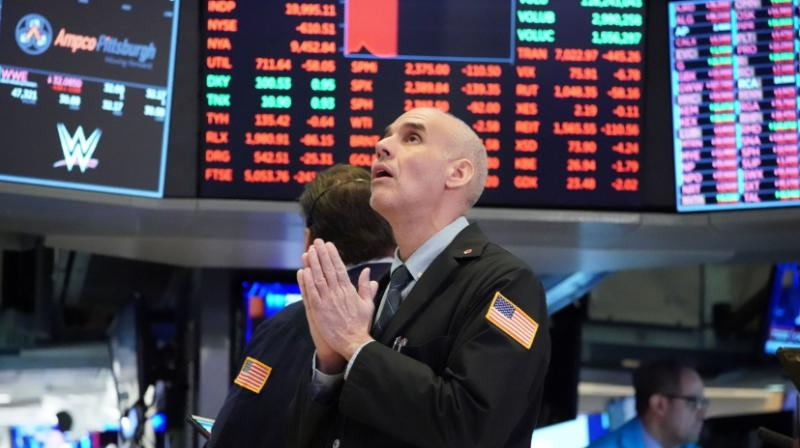 Traders on the floor of the New York Stock Exchange on March 18. (Photo- AFP)
