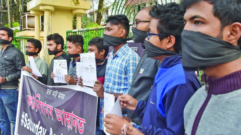 Students of Cotton University tie their mouth with black cloth as they stage a protest against the CAA in Guwahati. (Photo: PTI)