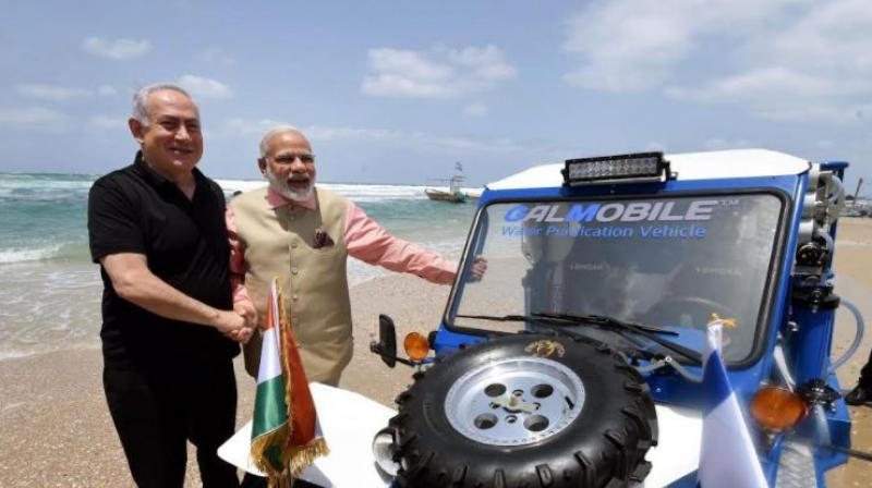 Netanyahu and Modi waded into the Mediterranean Sea and rode the 'buggy' jeep on the coast during the latter's visit to Israel in July 2017. (Photo: Twitter/@PIB_India)