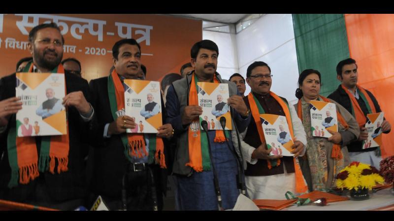 Delhi BJP president Manoj Tiwari with Union ministers Nitin Gadkari, Prakash Javadekar, MPs Meenakshi Lekhi and Gautam Gambhir at the launch of 'sankalp patra' for Assembly election in New Delhi on Friday. (Photo: G.N. Jha)