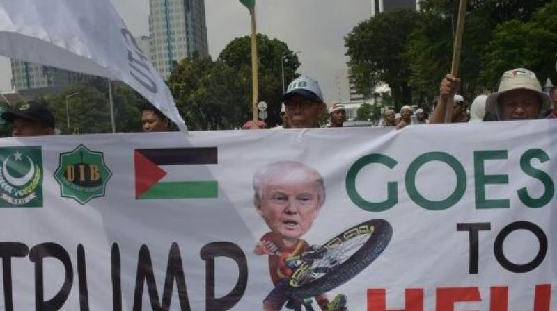 80,000 protesters gathered at the National Monument, waving the Palestine flag and banners reading 'Free Palestine' as they chanted 'God is greatest!', says police. (Photo: AFP)