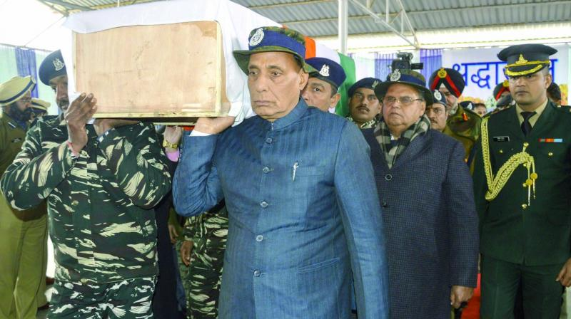 Union home minister Rajnath Singh shoulders the coffin of a slain CRPF jawan in Budgam on Friday. (Photo: PTI)