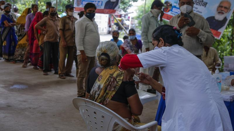 A woman is administered the Covishield vaccine against the coronavirus at an urban health centre in Ahmedabad. (Photo: PTI)