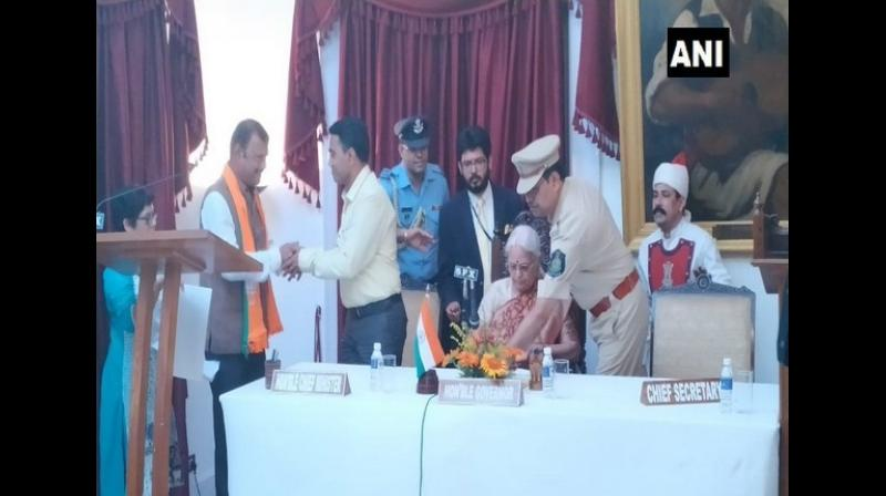 Sanvordem MLA, Prabhu Pauskar was inducted into the Council of Ministers at a ceremony held at Durbar Hall Donapaula on Thursday. (Photo: ANI)