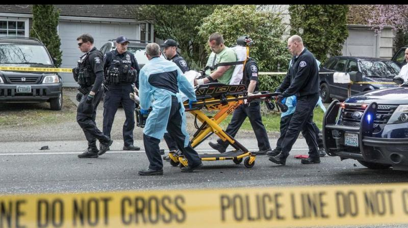 The incident unfolded in a northeastern Seattle neighbourhood when the suspect approached a motorist at an intersection and shot her before walking into the street and firing on the bus, police said in a statement. (Photo: AP)