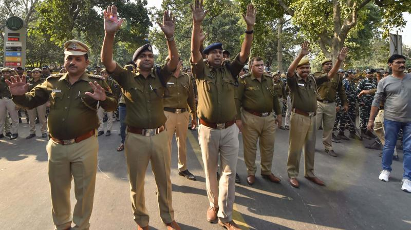 Police personnel manage the crowd as All-India Students Association members protest against JNU fee hike in New Delhi on Friday. (Photo: PTI)