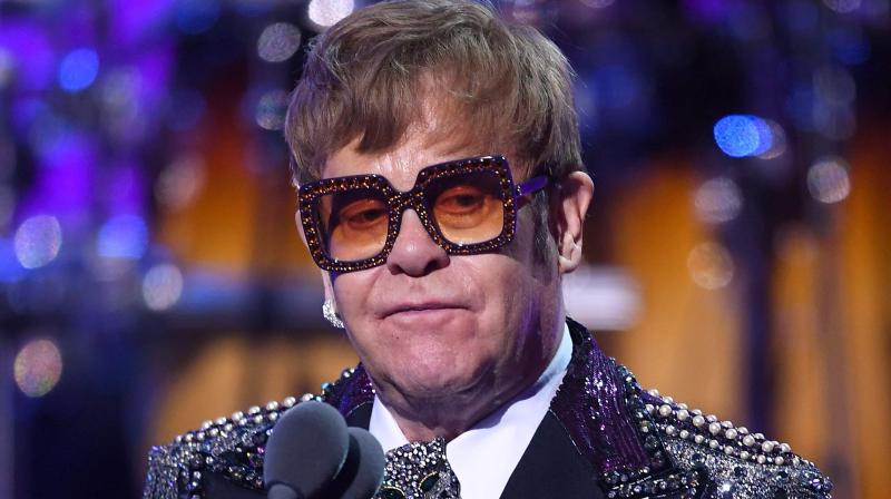 Elton John performs on stage during the