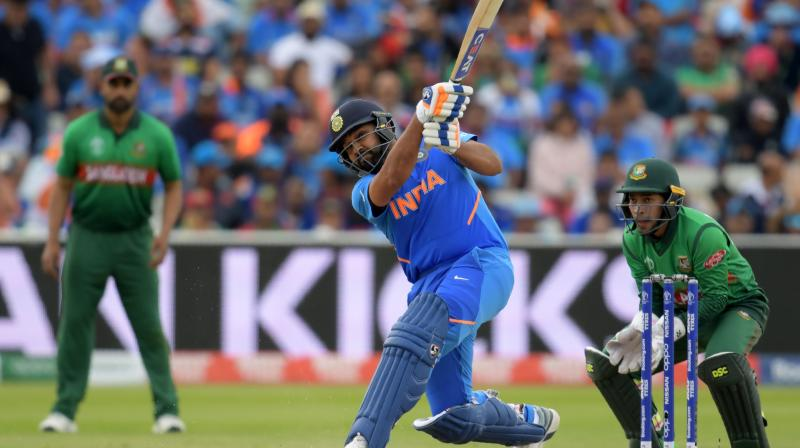 It was Rohit's (104 off 92 balls) record-equalling fourth century in a single edition and his 180-run opening stand with K L Rahul (77 off 92 balls) that laid the foundation for a par-score of 314 for nine after India opted to bat. (Photo: AFP)