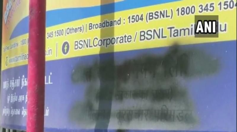 Text in Hindi language on signages at the BSNL office and the Post Office outside Trichy Airport was painted black on Saturday by unidentified people. (Photo: ANI)