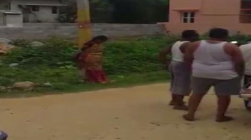 In the video, a woman is seen tied up to a pole and some men are standing around her. (Photo: ANI)