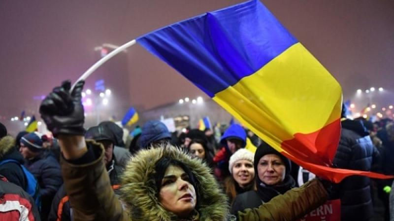 Protestors protest on Mondat might in Bucharest, a day after the Romanian government repealed an emergency decree that would have turned a blind eye toward political corruption. (Photo: AFP)