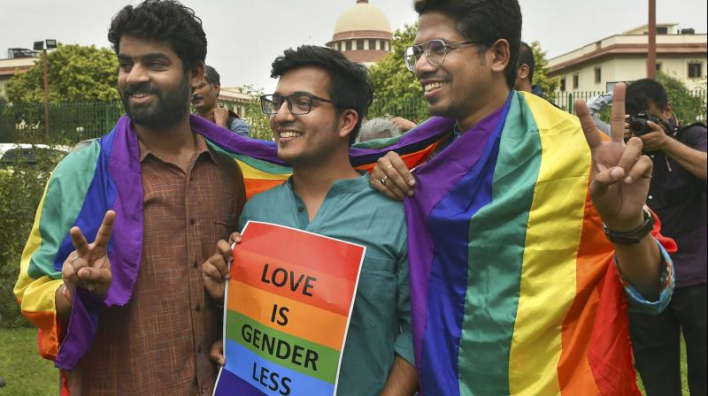 People react after the Supreme Court verdict which decriminalises consensual gay sex, in New Delhi. (Photo: PTI)