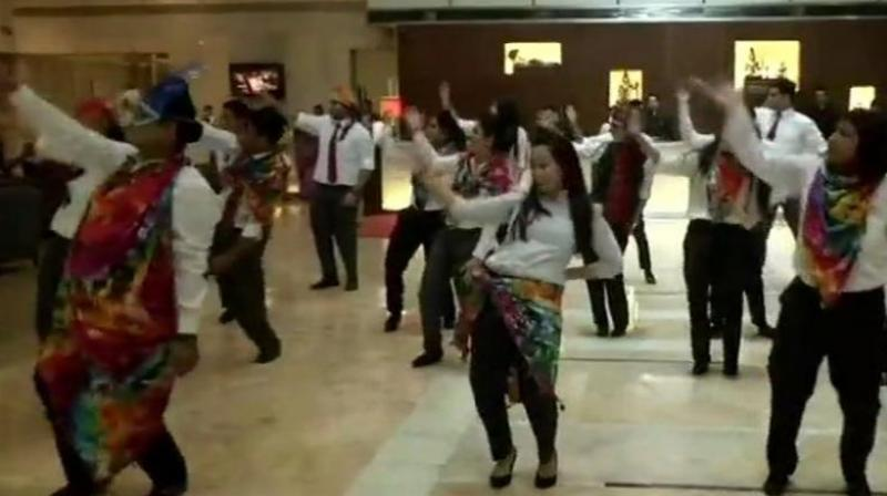 In the video, the staffers also urged people to join in the celebrations. (Photo: Twitter | ANI)