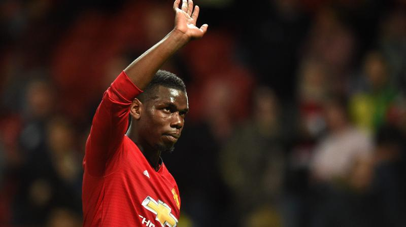 Pogba was the only player not from City or title challengers Liverpool to make the PFA team of the year this week. (Photo: AFP)