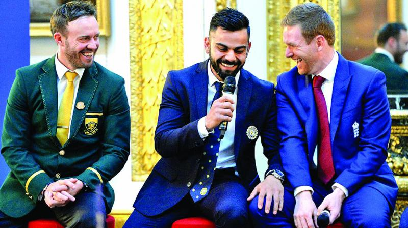 A file photo of AB de Villiers (left), Virat Kohli and Eoin Morgan sharing a lighter moment during an ICC event.