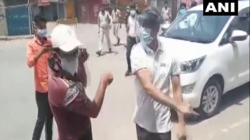 Sharma is then seen slapping the man and encouraging two policemen, who rush to the spot and start hitting the man with sticks. (ANI)