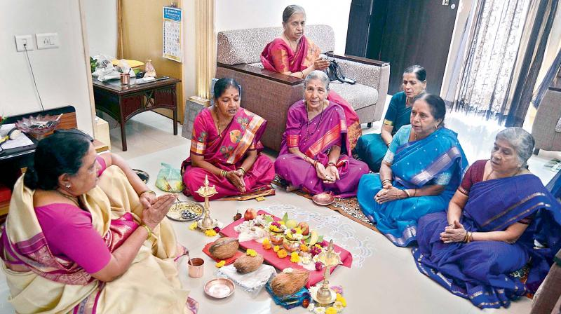 A priestesses performing puja at one of the houses. (Photo: Ravi Joshi)