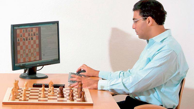 A file photo of Grandmaster Viswanathan Anand playing chess with a computer.