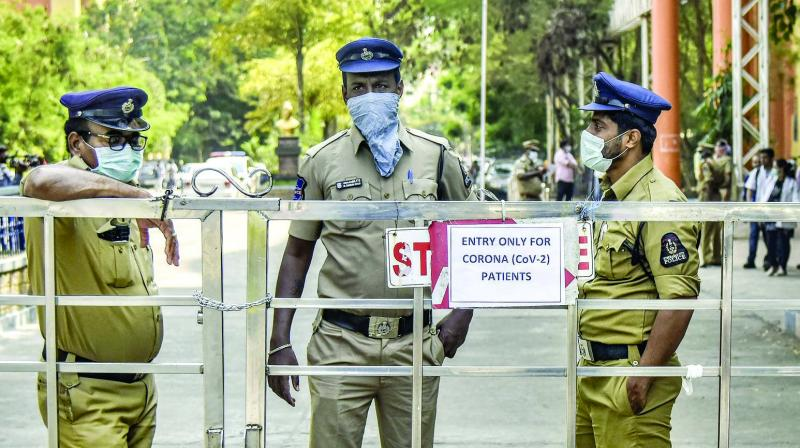 Security personnel wear protective masks in wake of the deadly novel coronavirus at Government Gandhi Hospital in Hyderabad. PTI Photo