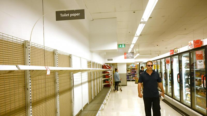Shelves are empty of toilet rolls in a supermarket in Sydney. AFP Photo
