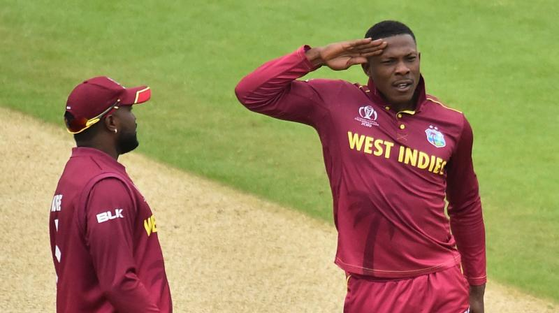 Sheldon Cottrell, whose flamboyant wicket-taking celebration involves a short march, stand to attention and salute to the pavilion, will meanwhile be doing his best to get on Bayliss's nerves. (Photo: AFP)