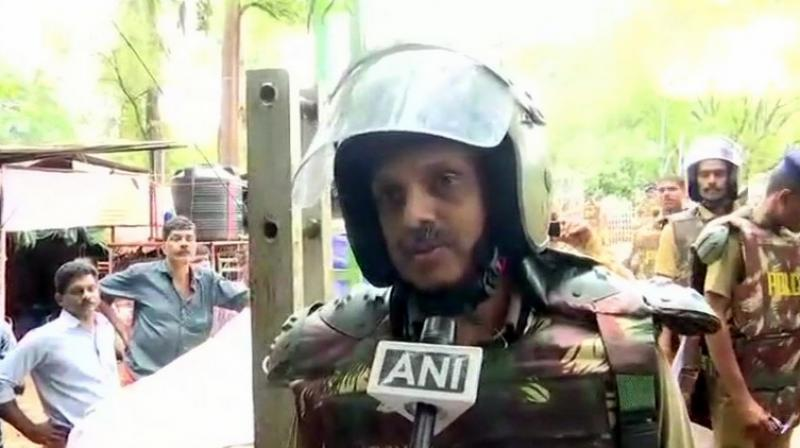 'I am also an Ayyappa devotee,' IG S Sreejith said while negotiating for the two women. (Photo: Twitter | ANI)