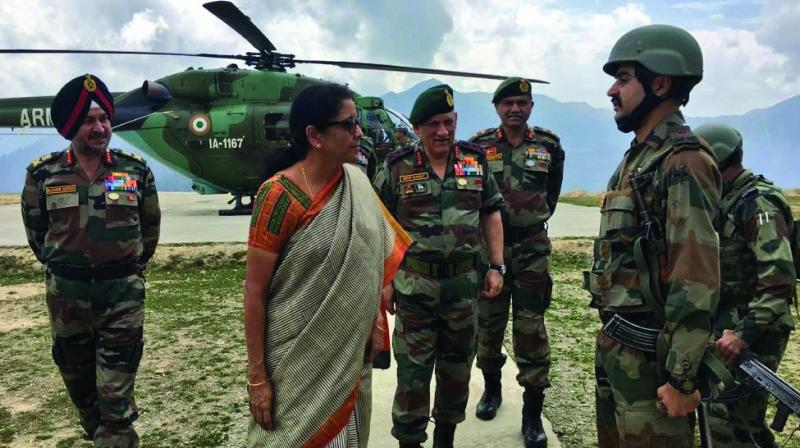 Defence minister Nirmala Sitharaman interacts with Army jawans and officers during a visit to an area along the Line of Control in J&K's Kupwara on Sunday.