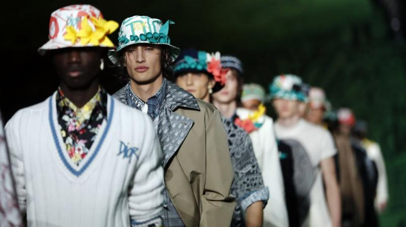 The collection's vacation feel continued with python printed shorts, sweater hoodies and conch shell earrings — relaxed but energetic. (Photo: AP)